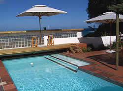 Backpackers Beach House Lodge 4 star backpackers accommodation in Plettenberg Bay is literally seven steps from the beach